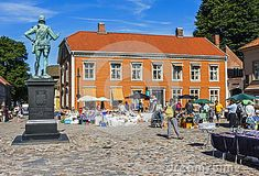 An art market in the old town of Fredrikstad, Aust Agder, Norway. Old Town is the oldest part of Fredrikstad city. It was founded 12 september 1567. The fortifications from 1660s makes it to Northern Europes best preserved fortress town. The old houses of the image is typical of the old city.