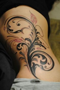 See more Pink and Black flower tattoo on side body