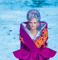 She looks ridiculous the only person that can pull the dress off though is effie