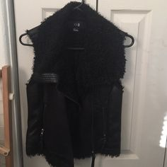 Forever 21 black faux leather fur lined vest Forever 21 black faux leather fur lined vest. Size S. Only worn 1-3x. I live in FL it only gets that cold for a couple days out of the year. Great for cold weather and layering. Really soft material too.  The pictures really don't do it justice.  Will ship same day (if possible) Forever 21 Jackets & Coats Vests