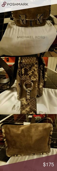 AUTHENTIC Michael Kors Bag Suede and leather python  bag. This is a beautiful bag with two nice size front pockets and plenty space inside bag. I only wore bag 2 times. There are no stains, tears, smell, or damage to this bag. Perfect condition!I  just got so many bags that I didn't carry this bag but one time. Open to offers Michael Kors Bags Crossbody Bags
