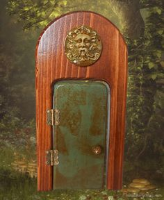 A green man fairy door that opens for your miniature fairy gardens.