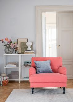 Coral red armchair with a velvet cushion | IKEA Stocksund armchair with a Pomela Peach Skin Romo x Bemz cover | Velvet Designers Guild x Bemz cushion cover