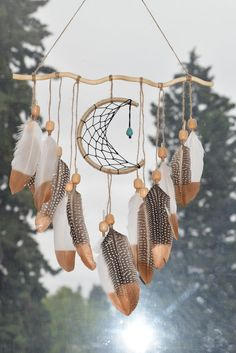 Next time you find a twig, just transform it into a beautiful dream catcher. Feathers, beads and a few strings is all you need to make this eye-catching dream catcher. Teens can even make and sell this lovely dream catcher for pocket money. Native American Decor, Native American Fashion, Native American Nursery, Dreams Catcher, Los Dreamcatchers, Moon Dreamcatcher, Dream Catcher Craft, Dream Catcher Mobile, Making Dream Catchers