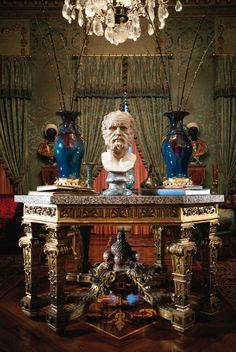 Baroque giltwood table with the marble bust and two porcelain vases