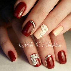 Get the burning passion this summer with these bold red nail art design. The nails with the nude nail polish look absolutely soft and adorable in contrast to the strong hue of the red color. Tone down the contrast with some beads on top as well as flower embellishments.