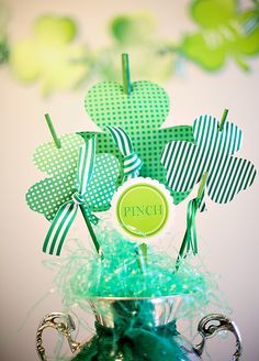 cute, no-flower centerpiece option...or make the clover-sticks and put them in arrangements all about the house!