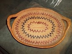 This table tray was made by a member of the Salish Tribe of the Pacific Northwest Coast. Tribal members live in British Columbia, Canada and in Oregon and Washington in the United States. This tray is old, probably from the 1930's or so and it is gorgeous still!  This basket is 20 inches in length and 12 inches in height.
