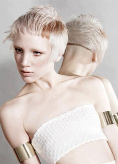 Platinum blonde pixie with very short straight bangs