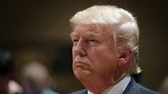 Republican presidential candidate Donald Trump visits a caucus site Monday in West Des Moines, Iowa.   (AP Photo/Jae C. Hong)