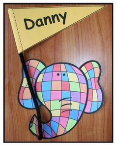 """Name activities: Elmer-inspired """"proud pennant"""" craft. Children color their elephant however they want, trim the flag, write their name on it and attach with a pipe cleaner.  Cute bulletin board for BTS. Includes a poster for the center of your display."""