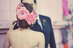 Mexican - inspired wedding hair with flowers.