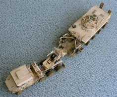 Here are some images of Hobby Boss's 1/35 scale Oshkosh M1070 Truck Tractor & M1000 Heavy Equipment Transporter Semi-Trailer with Tru...
