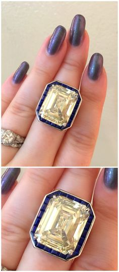 An incredible engagement ring by Oscar Heyman. This stunner features a 17 ct diamond (!!!!) surrounded by blue sapphires.