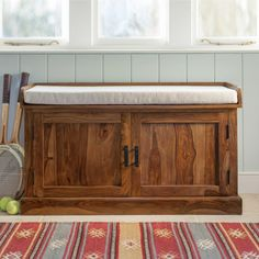 Beautifully hand crafted from solid Sheesham wood, this Mallani Enclosed Storage Seat hides a mountain of outdoor gear behind two panelled doors.