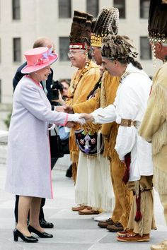 Queen Elizabeth II and Prince Philip meet Native American Indians at the State Capitol Building on the first day of their USA tour on May 3, 2007 in Richmond, United States