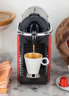 Nespresso Pixie Carmine | This machine has a range of innovative, advanced features, all found in a surprisingly small package.