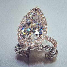 Exquisite. || Custom-made Pear-shaped Diamond Halo Engagement Ring in 14k Rose Gold and coordinating diamond wedding band || Derco Fine Jewelers www.dercodiamonds... #weddingring
