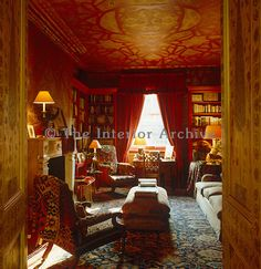 Rich colours, opulent patterns and sensuous textured fabrics combine to create a feeling of luxury and comfort in this library