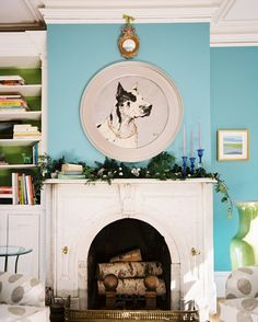 Fireplace Photo - A portrait of a dog above a mantel decorated for the holidays