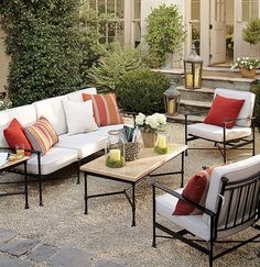 Love this patio set. Some different and bright colored pillows would make this awesome.