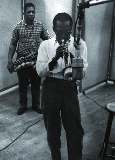 John Coltrane with Miles Davis, 1958, Columbia Recording Studios, New York, NY. Photo by Aram Avakian.