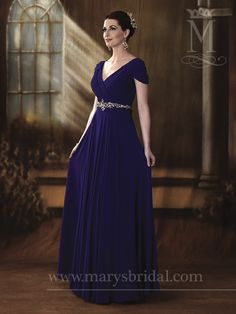 This beautiful chiffon gown features a plunging V-neckline and a beaded belt to accent the natural waist. This mother's dress is stunning in a variety of colors, ready to suit any wedding desire!