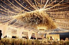 incredible tent canopy gold streamers bistro lights events weddings