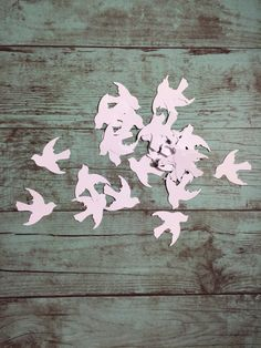 25 White dove hand punched diecuts. Each dove measures roughly 1W. These are great for weddings,  themed parties, scrapbook pages,