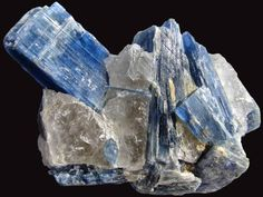 SOUTH AMERICA  Blue Kyanite Cluster    Beautiful large natural blue specimen of Kyanite crystals embedded in the quartz in which they formed. The Kyanite is of the highest quality, really deep blue to a darker vibrant blue that is translucent and gemmy. Mined in Minais Gerais, Brazil.