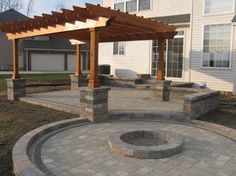 Pergola, patio, fire pit ring and looks like they were contending with egress windows and such too.