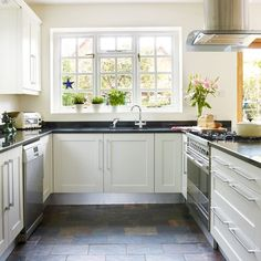 Light country style kitchen | Kitchen ideas | Love Slate floors with White Cabinets.