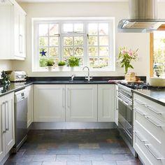 Slate floor, black worktops. Country kitchen