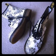 "RARE Floral Doc Martens Brand new RARE Doc Martens. Floral design. Silver on white with yellow stitching and black laces. Super cool!  I can't believe I am letting them go  not available in stores. Size 6 but fits my foot which is 6.5-7.  ""AirWair with bouncing soles"" Dr. Martens Shoes Combat & Moto Boots"