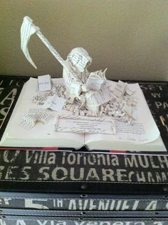 The Book Thief by Markus Zusak// Book sculpture by Rebecca Rupnow (http://www.etsy.com/people/BeckyJArts)