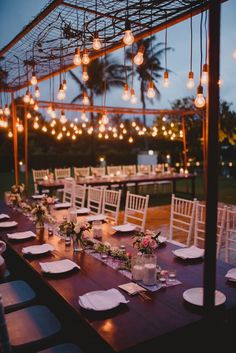 outdoor wedding table setting with hanging lights #bali #tropical #wedding