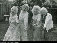 Group of women, laughing and dancing