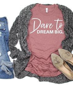 Dare To Dream Big. Do you know someone that has a big dream? Do they need a little encouragement to keep them going? If so, give them our Dare To Dream Big T-Shirt and show them you believe in them and their dream.This t-shirt is super soft, luxurious, and crafted in an eco-friendly facility! Funny Shirt Sayings, Shirts With Sayings, Teaching Shirts, Chasing Dreams, Personalized T Shirts, Casual Elegance, Custom T, Cute Shirts, Dream Big