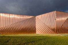Copper panels clad the facade of Poland's Museum of Fire