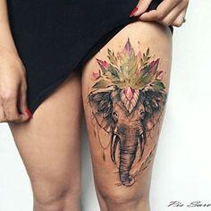 Este elefante colorido.   23 Lindos tatuajes que los amantes de los animales adorarán