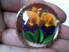 vintage reverse carved lucite pancy flower brooch