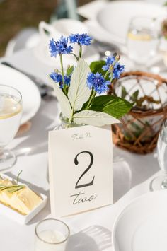 Blue cornflowers and simple table numbers:  Taylor'd Events » A Lovely Wedding At Sleeping Lady Mt. Resort | Florist: McKenzie Powell Floral & Event Design; Photography: Amelia Soper Photography #Washingtonwedding #mountainwedding #leavenworth #tablescape #wildflowers