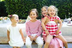 Kids laughing for a candid photo at a red and white themed cherry party