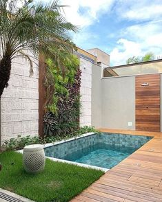 Small backyard pool with wooden decking and grass turf around it to reduce mantainence.The wall is treated with vertical garden, stone and woosen cladding as well. modern Backyard with pool Backyard pool with vertical garden. Small Backyard Design, Backyard Patio Designs, Modern Backyard, Small Backyard Landscaping, Backyard Ideas, Small Pool Backyard, Small Garden With Pool Ideas, Small Indoor Pool, Indoor Pools
