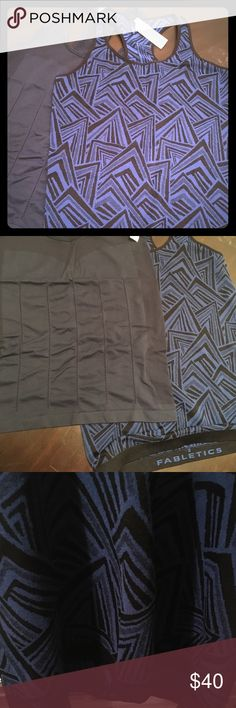 2 Fabletics workout tanks - Size M Selling 2 Fabletics tanks together. Close up pictures of tanks are more accurate colors. Dark blue tank is stretchy. Printed blue/black tank is Nylon/Polyester. Form fitting, size Medium Fabletics Tops Tank Tops