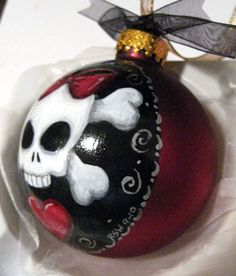 "Girly skull glass ornament. Perfect for our ""Halloween"" themed Christmas."