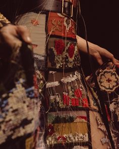 An embroidered dress is inspired by the needlework created by creative communities in Cornwall.
