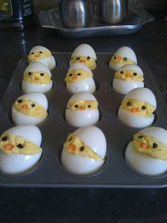 Hard boil eggs. Cool. Stand them up point at top and cut about 1/3 down.  Scoop out filling and make devilled eggs (no paprika!).  Set in muffin tin then fill with mixture and place top piece on.  Eyes are bits of black olive.  Beaks are a carrot slice which you cut into little wedges like a pie.  Cover with plastic and refrigerate until serving.