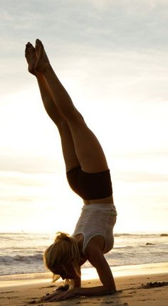 Wouldn't it be great to look like (and be able to do) this? On my next vacation at the beach I'll get right on it...just hanging out on my forearms, upside down, at sunset. (who are we kidding? I'm sure it's sunrise!)