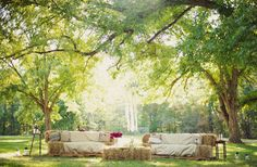 Hay bale wedding lounge area, okay they are really straw bales most likely, a huge misconception to the non-farming world, Straw is a trash crop, hay is food. BUT the point is, no one wants to sit on either in anything but jeans or leather pants! So to cover them would make beautiful outdoorsy/countryesque seating.